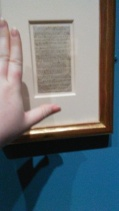 A page of Emily's poetry (most of Emily's Gondal papers were lost or destroyed). Hand for size comparison.